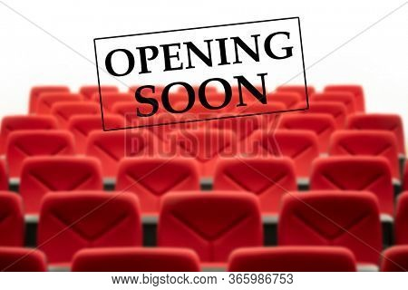 Opening soon sign on a cinema seats. Cinemas and theater reopening after coronavirus pandemic.