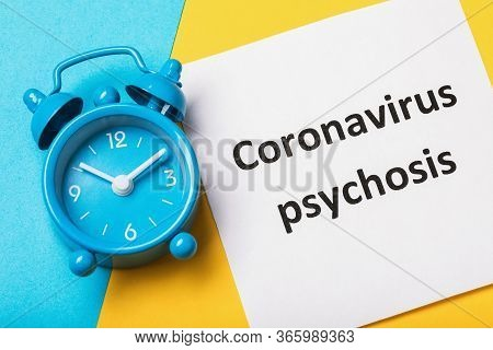 Alarm Clock And Note With Text. The Concept Of How Long The Psychosis Due To Coronavirus Will Last