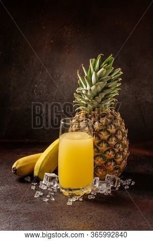Delicious Cold Refreshing Banana Smoothie Drink In Cocktail Glass With Ananas