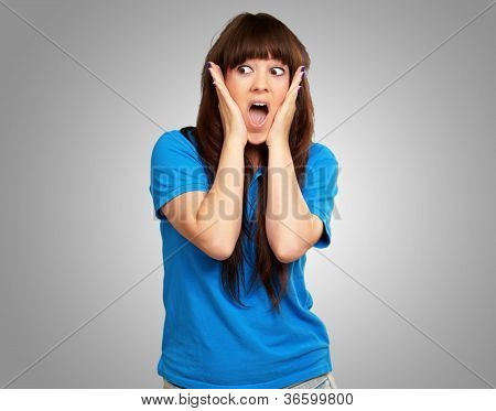 portrait of surprised woman isolated on gray background