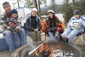 Family in front of campfire ready to toast marshmallow poster