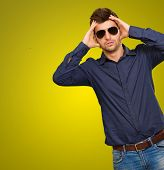 Tilt Shot Of Stressed Man Isolated On Yellow Background poster