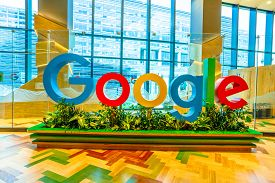 Singapore - May 5, 2018: Google Logo Inside The New Offices Of Google Headquarters In Mapletree Busi