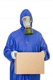 A Man In A Gas Mask Holding Carton Box In Hands. Delivery Of Goods During Quarantine. Online Shoppin