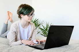Distance Learning Online Education. Teen Schoolgirl Studying At Home, Using Laptop. Caucasian Girl W