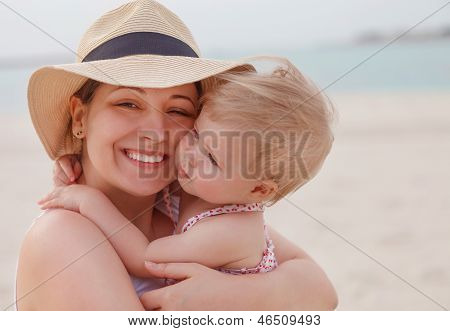 Portrait Of Mother Holding Her Bay Girl At Beach