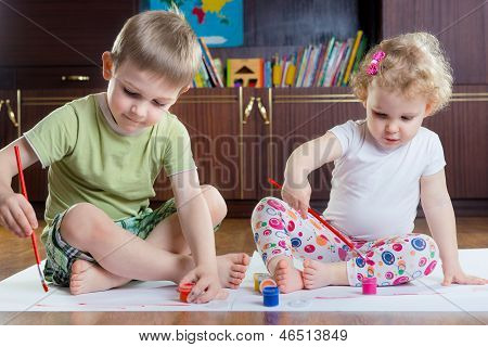 Cute brother and sister painting with colorful paints poster