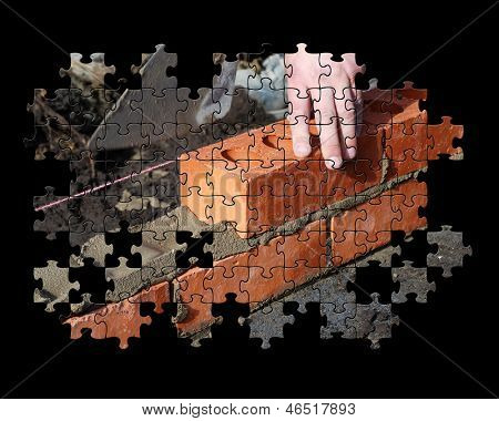 Partial jigsaw puzzle showing builder laying bricks