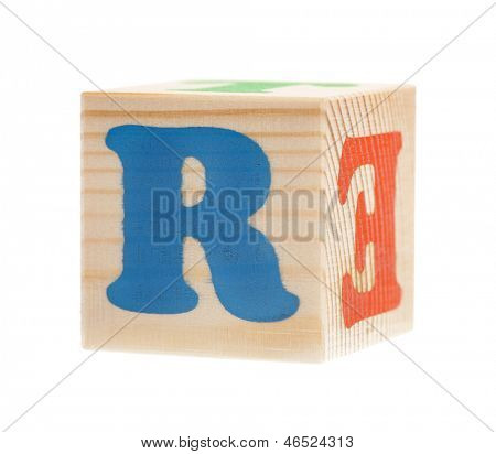 Wooden block with letter R, isolated on white background