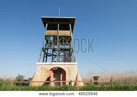 Wildlife observation tower inside a natural park poster