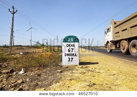 Okha Dwarka Milestone Truck Going Past