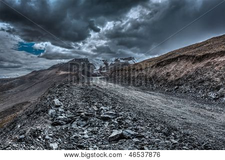 Road in Himalayas near Tanglang la Pass  - Himalayan mountain pass on the Leh-Manali highway in stormy weather. Ladakh, India