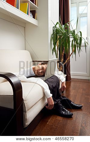 a deep dejection fell upon him. deflated man with laptop