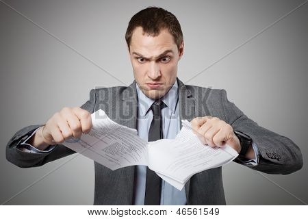 Businessman tearing contract