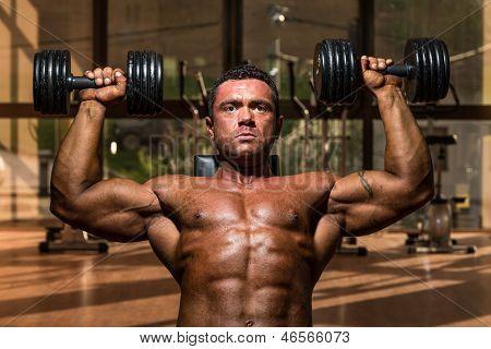 Male Bodybuilder Doing Shoulder Press Whit Dumbbell