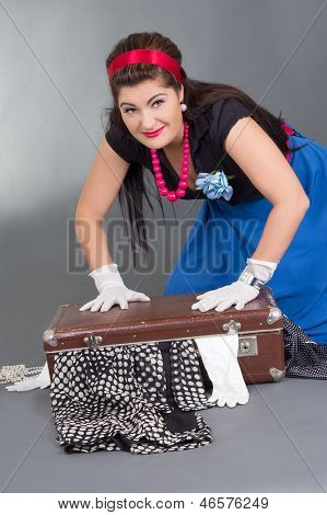 Funny Pinup Girl With Overfilled Suitcase
