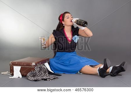 Sitting Pinup Girl Drinking Champagne
