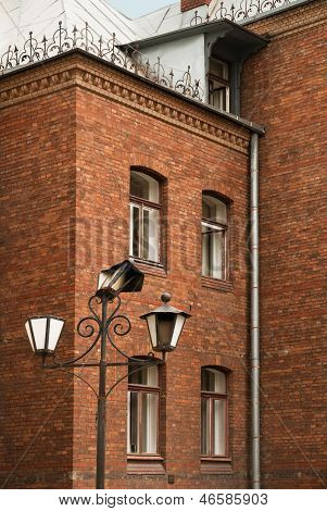 Old Lantern In A Court Beautiful Brick House