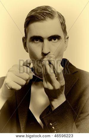 Retro Portrait Of Adult Man Smoking Pipe