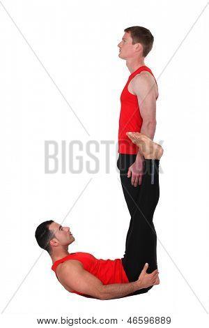 Men in gymwear making the letter J