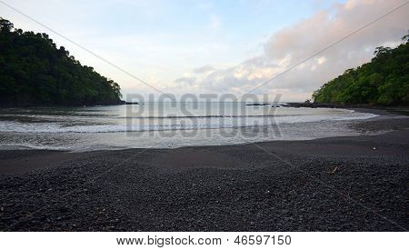 Beach In Panama Surrounded By Tropical Rainforest