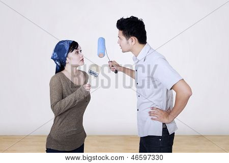 Asian Couple Argue While Painting
