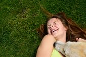 beautiful young happy laugh girl playing with her dog outdoor poster