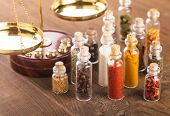 Little bottles with spices and scales on the table vedic cuisine poster