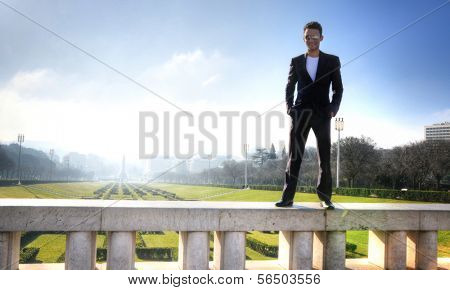 Man posing with the panorama of Eduardo VII Park in Lisbon, Portugal poster