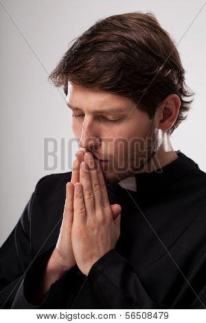 Vicar Praying Earnestly
