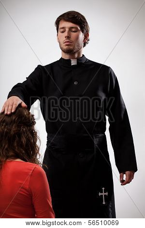 Priest Is Blessing A Believer