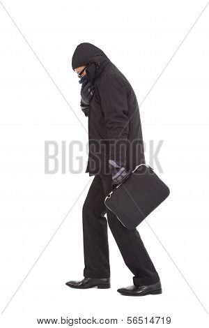 Young Businessman Shudder Body And Holding Briefcase