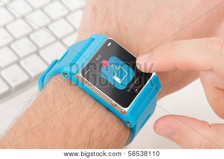Smart Watch On Male Hand With Like Icon