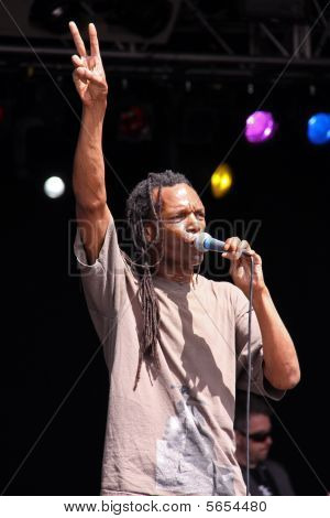 Ranking Roger and Ranking Junior of ska band The Beat singing on stage at Guilfest, Guildford, UK 12