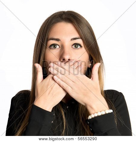 Pretty Young Girl With Her Mouth Closed By Her Hands