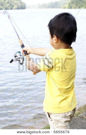 Asian boy fishing