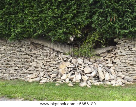 Dry stone wall falling down
