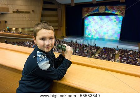 Boy In Theater