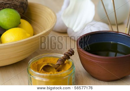 An Arrangement Of Spice, Oil And Massaging Tools Used In Ayurveda Massage