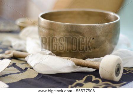 A Tibetan Singing Bowl With Baton