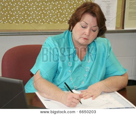 Middle Aged Business Woman Working At Her Desk