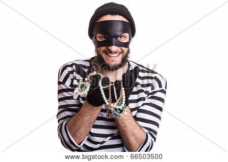 Thief showing stolen jewelry and smiling