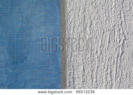 Closeup of layers over styrofoam insulation mesh plaster cement mortar poster
