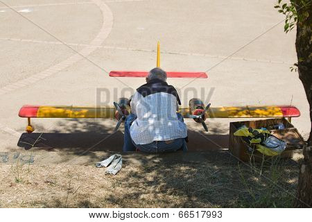 A Man Fixing His Rc Hydroplane