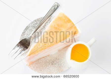 Crepe Cake With Orange Sauce Top View On White Background