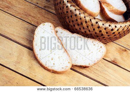 Two Slices Of Bread Near Wicker Breadbasket