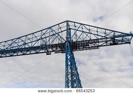 Longest remaining transporter bridge in the world. Opened in 1911 this bridge is still in operation. poster