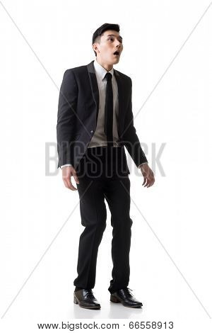 Asian business surprised with outrageously and funny pose, full length portrait isolated on white background.