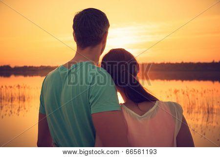 sunrise sea coast couple carefree embracing