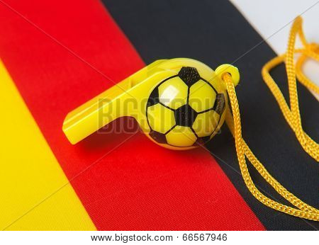 football shape whistle on Germany flag background.